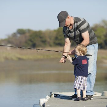 father and son or grandfather and grandson fishing